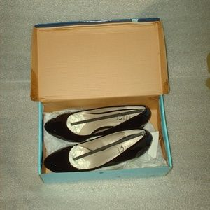 Brand new pair of Rouge Helium high heels w/ box